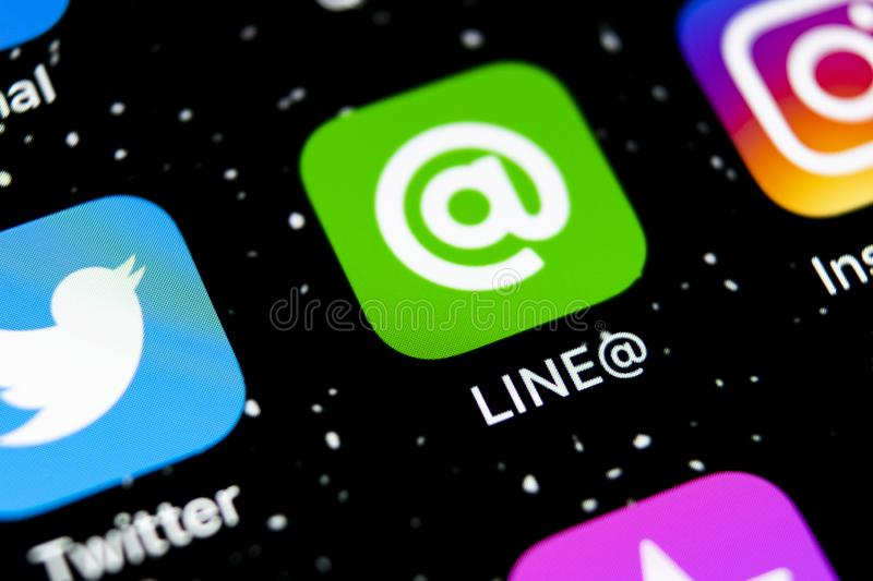 Line application icon on Apple iPhone X screen close-up. Line app icon. Line is an online social media network. Social media app. Sankt-Petersburg, Russia stock images