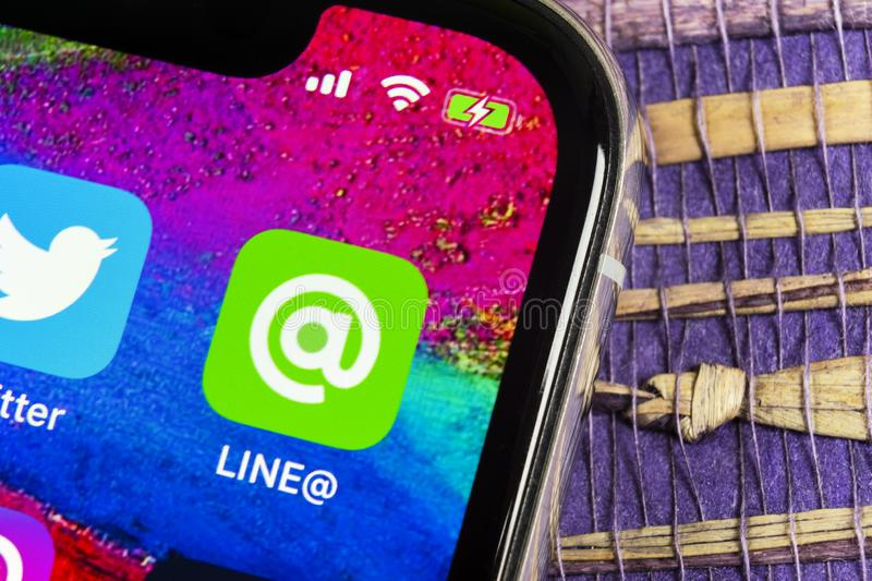 Line application icon on Apple iPhone X screen close-up. Line app icon. Line is an online social media network. Social media app. Sankt-Petersburg, Russia stock image