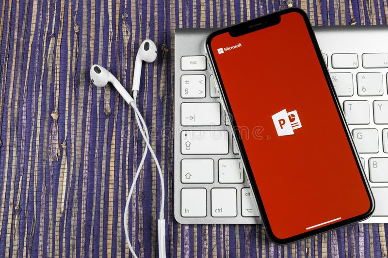 Microsoft office Powerpoint application icon on Apple iPhone X screen close-up. PowerPoint app icon. Microsoft Power Point applica. Sankt-Petersburg, Russia royalty free stock photography