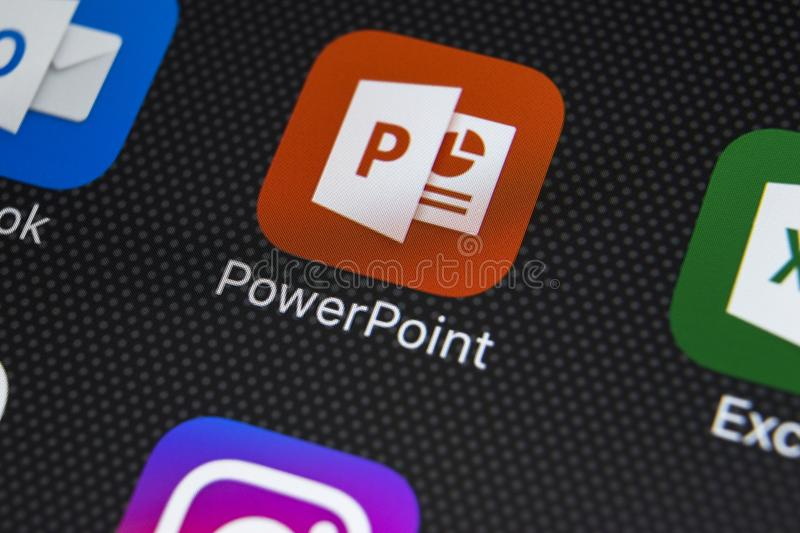 Microsoft Powerpoint application icon on Apple iPhone X screen close-up. PowerPoint app icon. Microsoft Power Point application. Sankt-Petersburg, Russia stock image