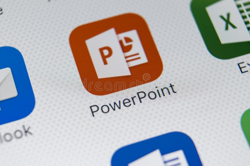Microsoft Powerpoint application icon on Apple iPhone X screen close-up. PowerPoint app icon. Microsoft Power Point application. Sankt-Petersburg, Russia stock photo