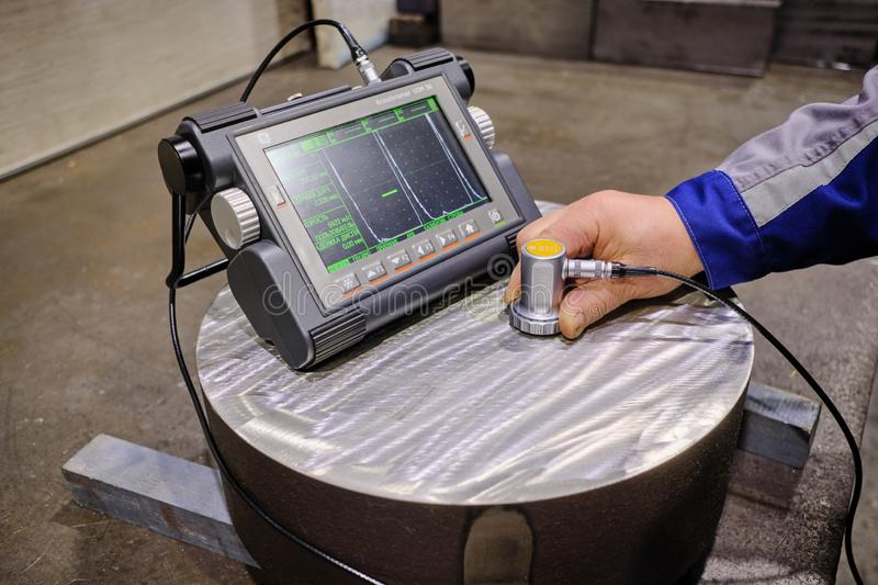 Ultrasonic flaw detector krautkramer USM 36 at the plant during accurate measurement of steel thickness. Sankt Petersburg, Russia - February 15, 2019: Ultrasonic royalty free stock images