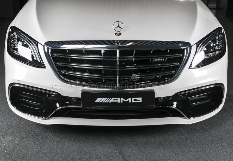 White Mercedes-Benz W222 S63 AMG 4matic V8 Bi-turbo exterior details. Headlight. Front view. Car exterior details. Sankt-Petersburg, Russia, January 12, 2018 stock image