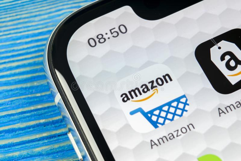 Amazon shopping application icon on Apple iPhone X screen close-up. Amazon shopping app icon. Amazon mobile application. Social me. Sankt-Petersburg, Russia stock photo