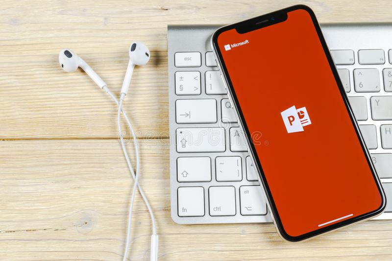 Microsoft office Powerpoint application icon on Apple iPhone X screen close-up. PowerPoint app icon. Microsoft Power Point applica. Sankt-Petersburg, Russia stock photography