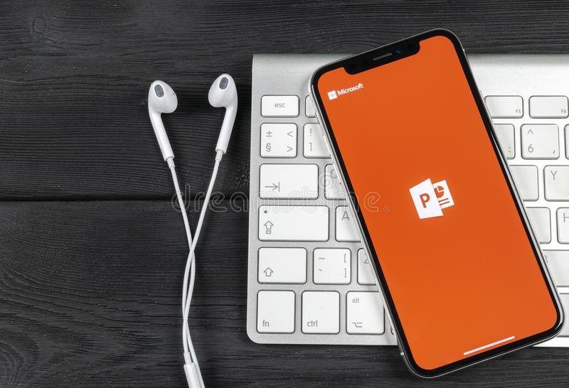 Microsoft office Powerpoint application icon on Apple iPhone X screen close-up. PowerPoint app icon. Microsoft Power Point applica. Sankt-Petersburg, Russia royalty free stock image
