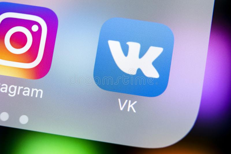 Vkontakte application icon on Apple iPhone X screen close-up. VK app icon. Vkontakte mobile application. Social media network. Sankt-Petersburg, Russia, March stock photo