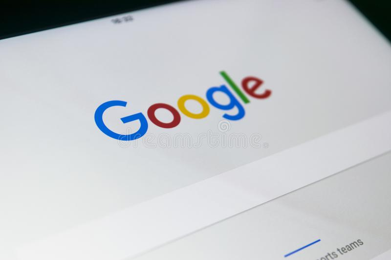 Google start web page on display of iPad Pro. Google is an American multinational corporation specializing in Internet related. Sankt-Petersburg, Russia, October stock image