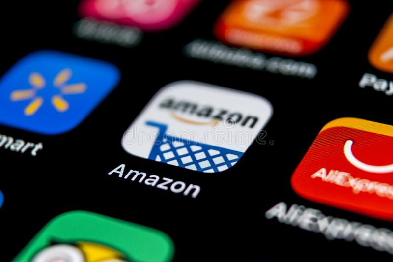 Amazon shopping application icon on Apple iPhone X screen close-up. Amazon shopping app icon. Amazon mobile application. Social me. Sankt-Petersburg, Russia stock image