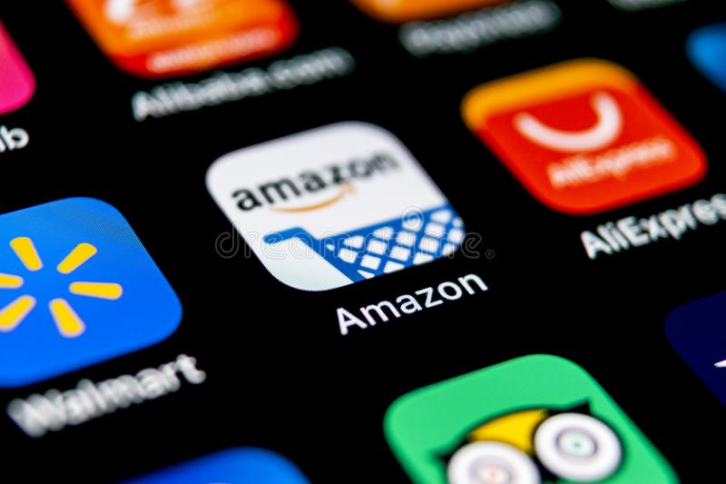Amazon shopping application icon on Apple iPhone X screen close-up. Amazon shopping app icon. Amazon mobile application. Social me. Sankt-Petersburg, Russia stock images