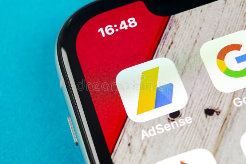 Google AdSense application icon on Apple iPhone X screen close-up. Google AdSense app icon. Google AdSense application. Social med. Sankt-Petersburg, Russia stock photography