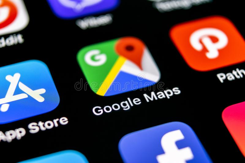 Google Maps application icon on Apple iPhone X screen close-up. Google Maps icon. Google maps application. Social media network royalty free stock image