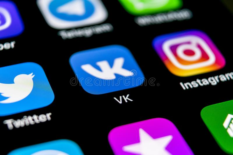 Vkontakte application icon on Apple iPhone X screen close-up. VK app icon. Vkontakte mobile application. Social media network. Soc. Sankt-Petersburg, Russia royalty free stock photos