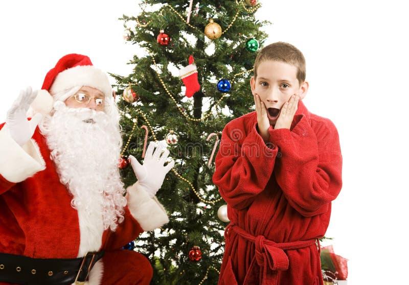 Sankt-und Kind-Weihnachtsüberraschung Stockfotos