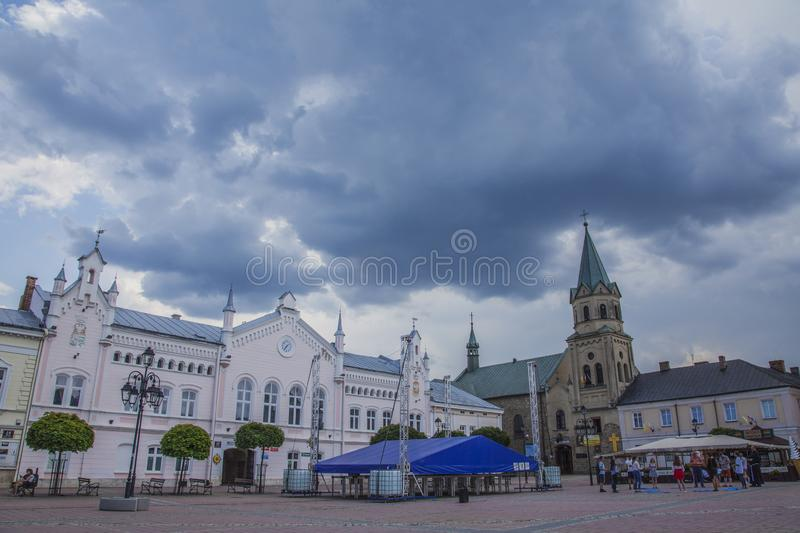 Sanok, Poland, Europe - cloudy skies and old buildings on the main square. This image shows a view of some cloudy skies and old buildings in Sanok, a small town royalty free stock images
