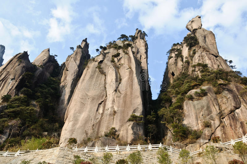 Sanqing mountain. The abrupt huge rock mountain with some small trees stock images