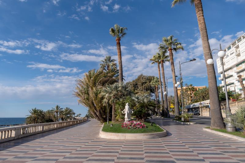 Promenade of the Empress Corso Imperatrice, Sanremo, Italy. Sanremo, Italy. Promenade of the Empress Corso Imperatrice flanked by palm trees, alongside the sea royalty free stock image
