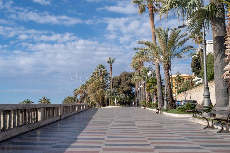 Promenade of the Empress Corso Imperatrice, Sanremo, Italy. Sanremo, Italy. Promenade of the Empress Corso Imperatrice flanked by palm trees, alongside the sea royalty free stock photos