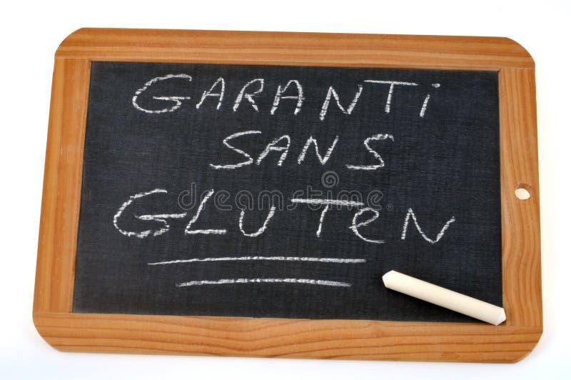 Sans gluten garanti écrit en français sur une ardoise d'école illustration stock