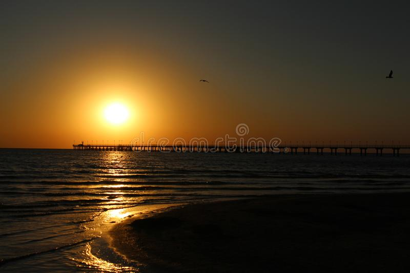 Sanset at sea. Beautiful sunset on the sea and on the horizon line mooring royalty free stock photos
