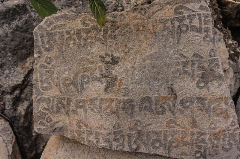 Sanskrycki mantry ska?y cyzelowanie Langtang park narodowy fotografia royalty free
