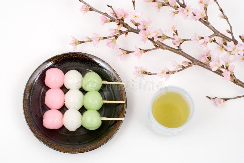 Sansyoku-dango and cherry blossoms stock photos
