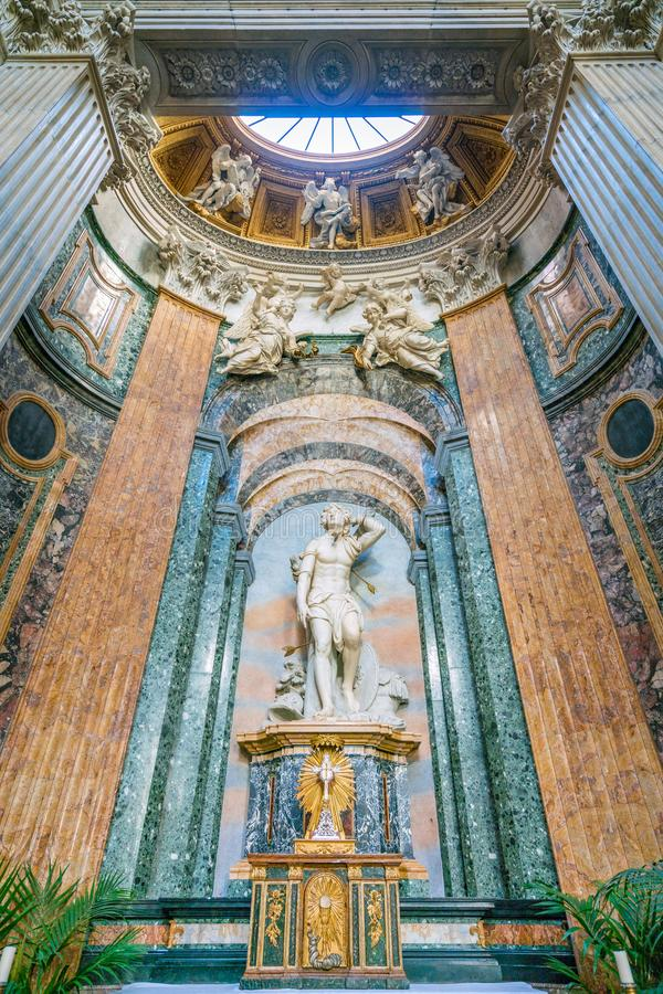 Statue of Saint Sebastian by Paolo Campi in the Church of Sant`Agnese in Agone in Rome, Italy. stock photography