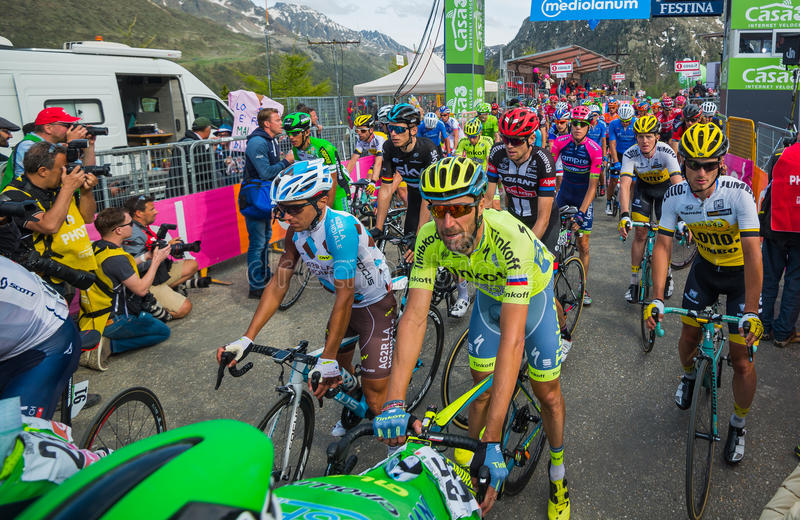 Sant Anna, Italy May 28, 2016; A Gorup of Professional Cyclists exhausted passes the finish line after a hard mountain stage stock photos