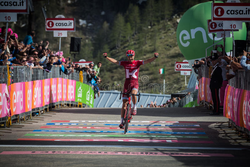 Sant Anna, Italy May 28, 2016; Rein Taaramae, Katusha team, exhausted passes the finish line and Win a hard mountain stage. With a uphill finish in Sant Anna di stock photo