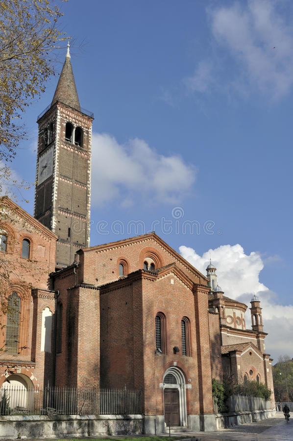 Sant eustorgio south side, milano. View from south of ancient church, shot in bright autumnal light royalty free stock photo