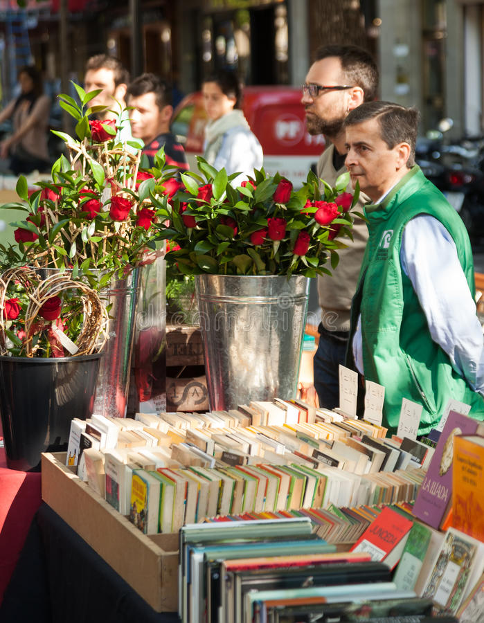 Sant Jordi is Catalan feast of Saint George in Barcelona. BARCELONA, SPAIN - APRIL 23, 2014: Sant Jordi is Catalan feast of Saint George in Barcelona. Books and stock photos