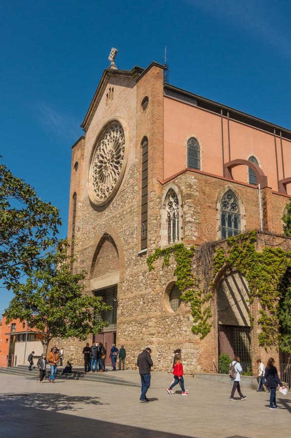 Sant Steven Granollers church catholic believers. At the end of the Sunday mass, several catholic christian believers come out of the main gate of Sant Steven royalty free stock image
