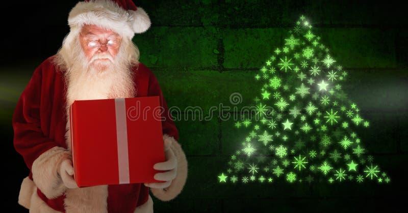 Santa δώρων και Snowflake εκμετάλλευσης πυράκτωση μορφής σχεδίων χριστουγεννιάτικων δέντρων πράσινη στοκ φωτογραφία με δικαίωμα ελεύθερης χρήσης