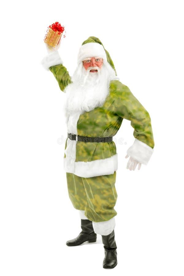 Santa που ρίχνει ένα δώρο στο άσπρο υπόβαθρο στοκ φωτογραφία με δικαίωμα ελεύθερης χρήσης