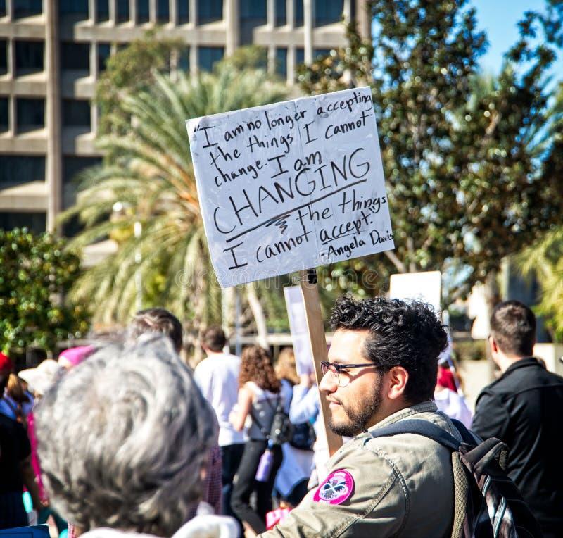 2018 Women`s March in Santa Ana, California. Santa Ana, California - January 20, 2018: Man standing up for women rights at the 2018 Women`s March in Santa Ana royalty free stock image