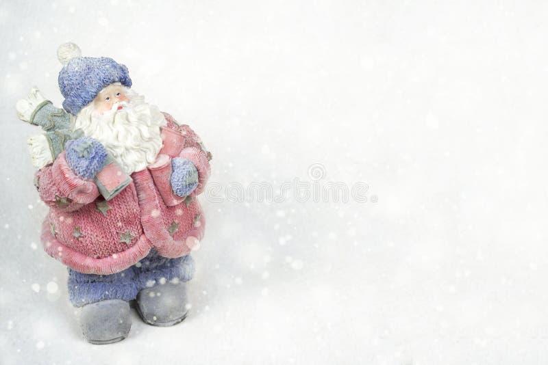 Santa avec le fond beige de cadeaux photos libres de droits