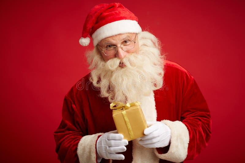 Santa avec le paquet image libre de droits