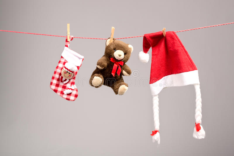 Santa bags, teddy bear and santa hat on a clothesline.  stock images