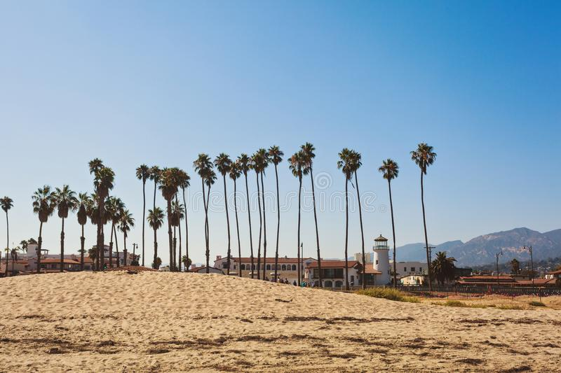 Santa Barbara sand beach with tall palms. And fancy building royalty free stock photos
