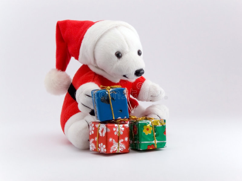 Santa bear and christmas presents stock photos