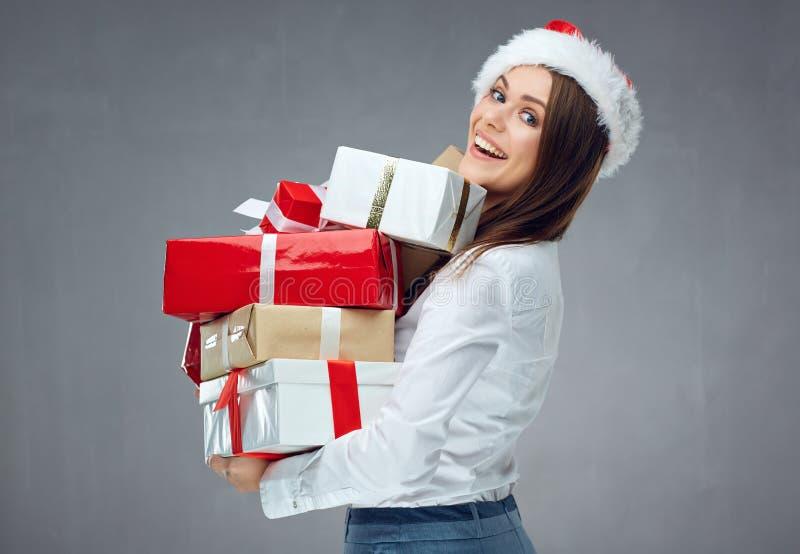 Santa bizneswomanu mienia stos boże narodzenie prezenty zdjęcia royalty free
