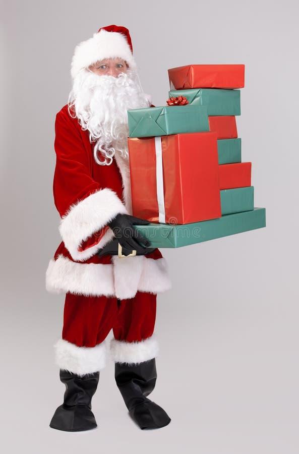 Santa bożych narodzeń podnośne teraźniejszość obraz royalty free