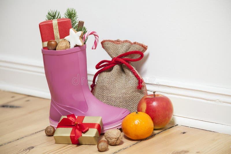 Santa Boots som en gumboot fotografering för bildbyråer