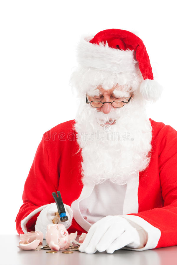 Santa breaking his piggy bank. Santa is breaking his piggy bank with only coins royalty free stock photo