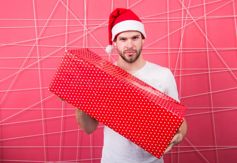 Santa bring gift for you. Man attractive santa claus carry big box. You deserve good gift. Christmas holiday celebration. Man handsome unshaven santa hat hold royalty free stock photography