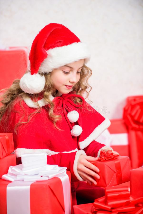 Santa bring her gift. Happy new year concept. Unpacking christmas gift. Winter holiday tradition. Opening christmas gift. Kid happy with christmas present royalty free stock image