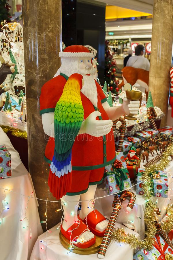 Santa Caribbean style complete with parrot & flipflops royalty free stock photos