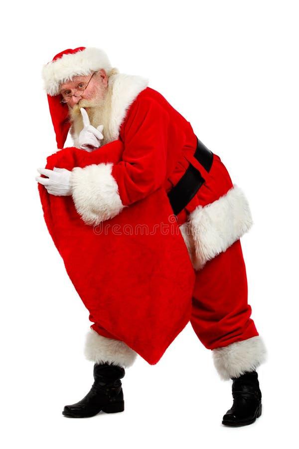 Santa carying teraźniejszość obraz royalty free
