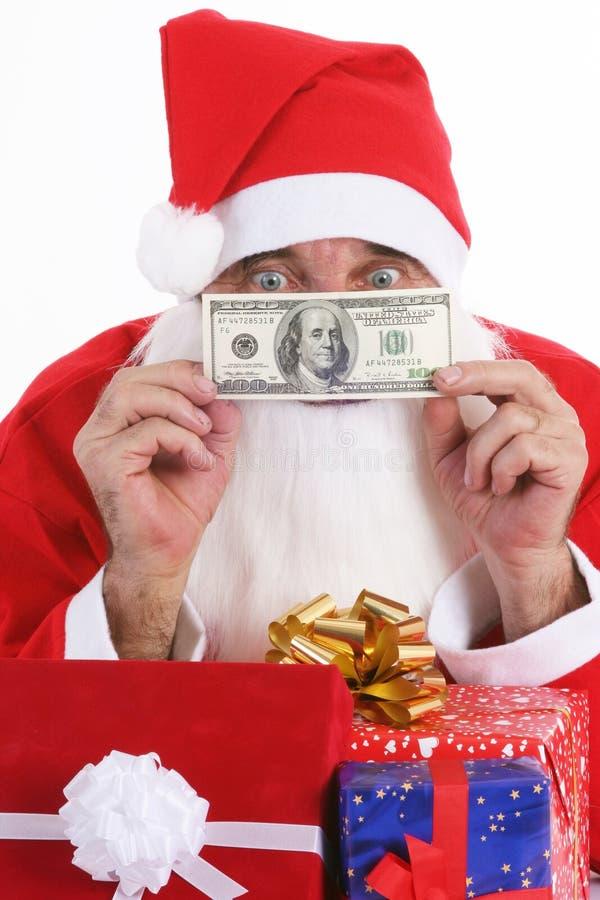 Santa che dà il regalo dei soldi   fotografia stock libera da diritti