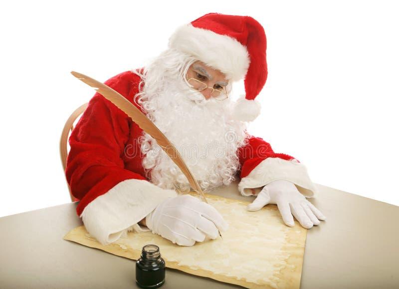 Santa che fa la sua lista fotografia stock libera da diritti